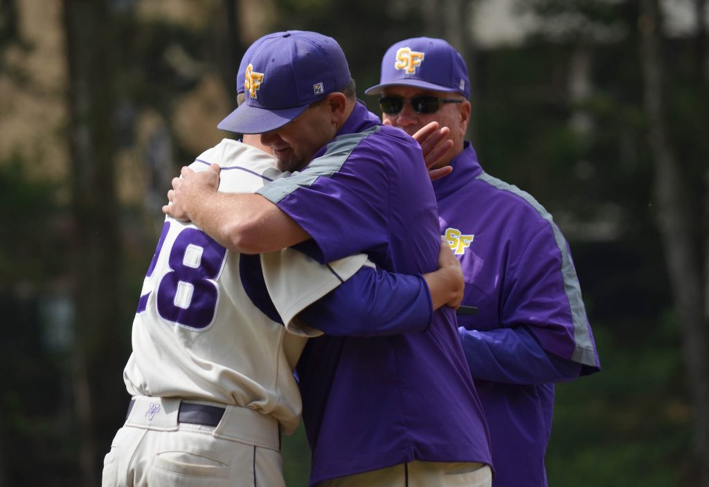 SF State senior gator Cory Davis (28) hugs the SF State baseball coaches during the senior ceremony before the game against Cal Poly Pomona at Maloney Field Sunday, May 3. (Melissa Minton / Xpress)