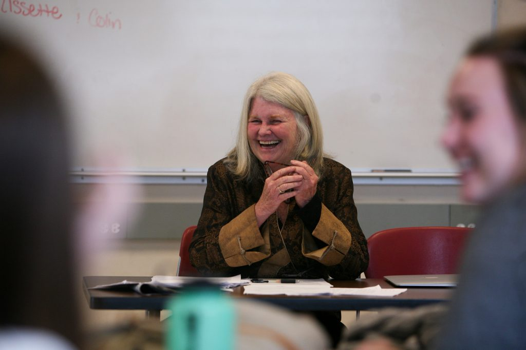 Yvonne Daley laughs at something a student said during her Feature Writing class Wednesday, April 22. This semester marks the end of her teaching career in the Journalism Department. (Daniel E. Porter / XPRESS).