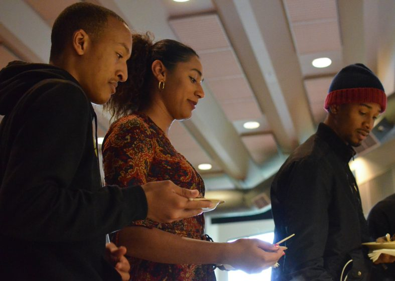 Students get food during the intermission at the screening of Hidden Colors 3: The Rules of Racism at the African American Health Fair in Jack Adams Hall Tuesday, May 5. (Melissa Minton / Xpress