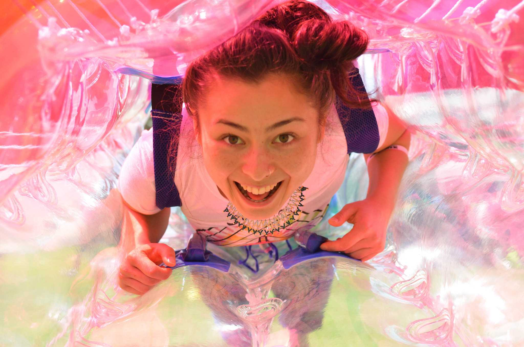 International relations major Nina Bazan-Sakamoto smiles while getting into a bubble for a game of bubble soccer in the Quad Tuesday, May 5. (Melissa Minton / Xpress)