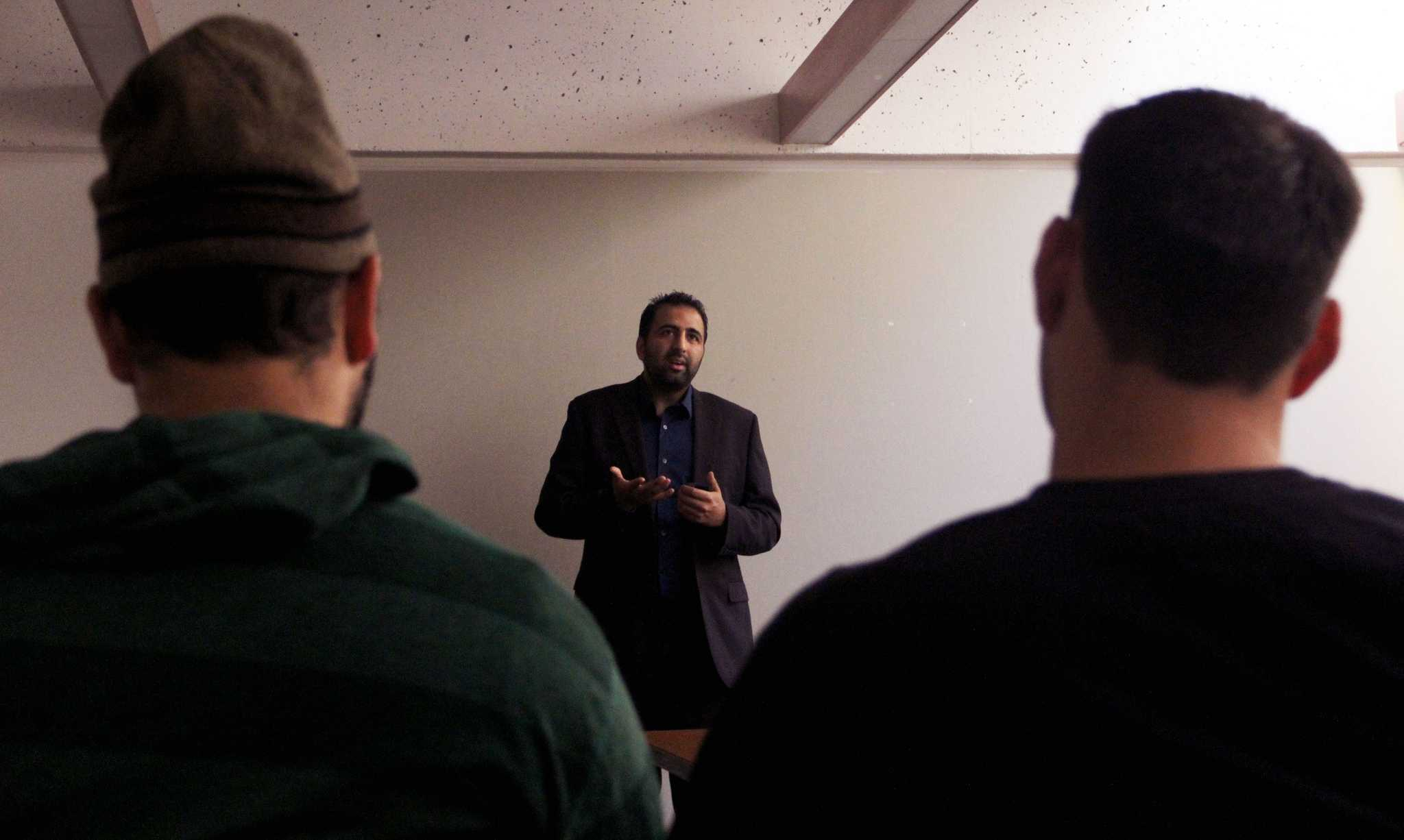 Muslim Zionist, Kasim Hafeez speaks with students about being Pro-Israel on Thursday evening, April 16,2015 at the SF State Rosa Parks conference room. (Angelica Williams / Xpress)