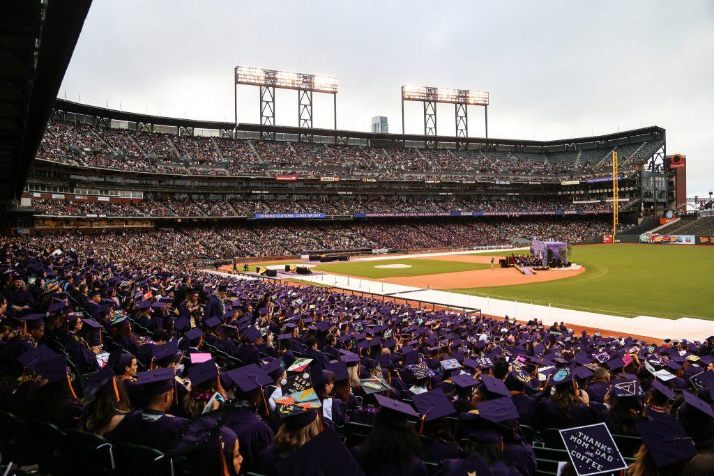 SF State graduates sit in the stands during the 114th Commencement ceremony held for the first time at AT&T Park Friday, May 22, 2015. (Jenny Sokolova / Xpress)