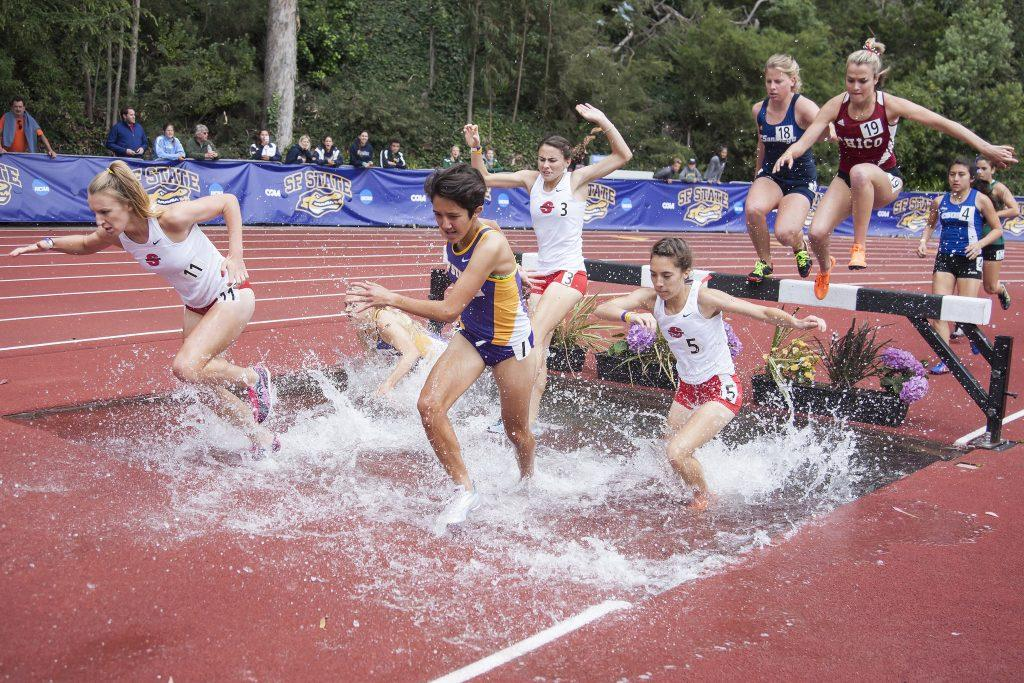 Adriana+Calva%2C+a+freshman+civil+engineering+major%2C+blasts+through+the+water+during+the+3000+meter+women%E2%80%99s+steeplechase+Sat.+May+2.+Calva+placed+11th+overall.+%28Martin+Bustamante+%2F+Xpress%29