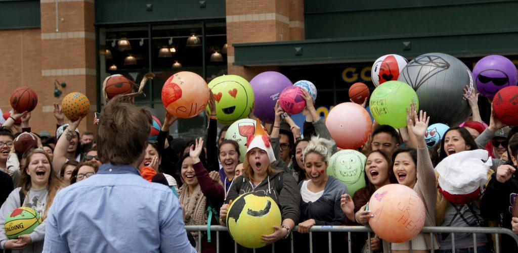 SF State students wait with hand designed Emoji balls while participating in a Twitter challenge during a recording of The Ellen DeGeneres Show at Dick's Sporting Goods in Daly City Monday, May 11. (Angelica Williams / Xpress).