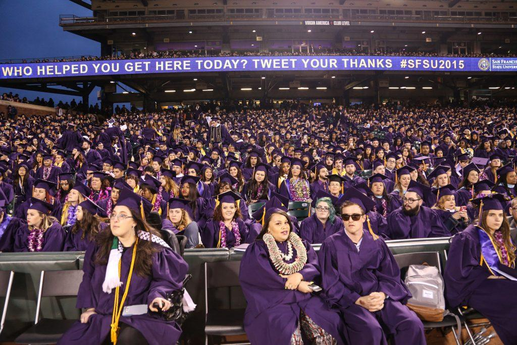 SF State graduates sit in the stands at AT&T Park after the 114th Commencement ceremony held for the first time at AT&T Park Friday, May 22. (Jenny Sokolova/ Xpress)