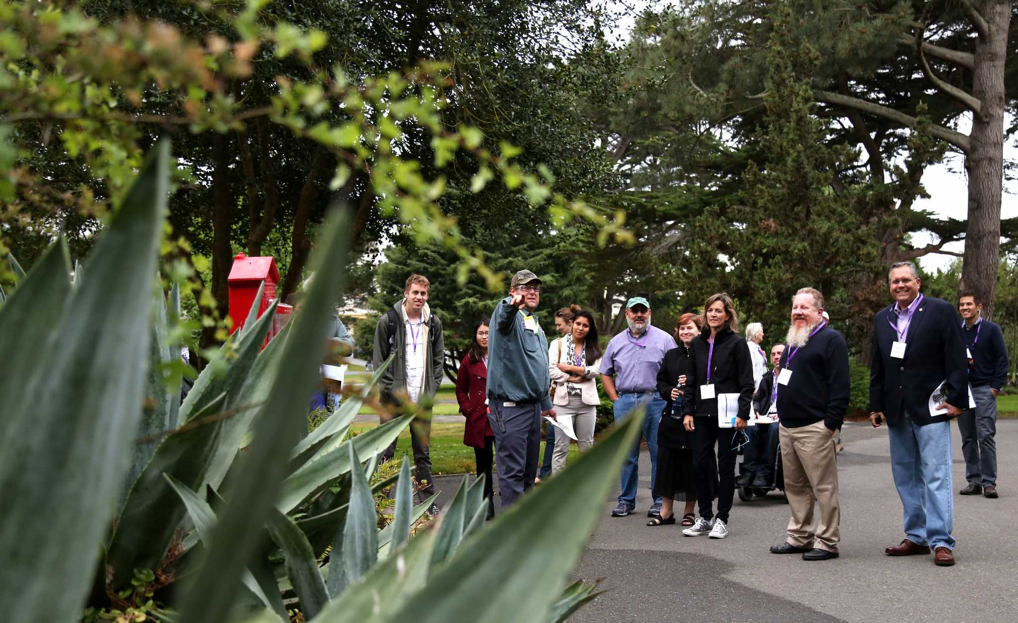 SF State gardener, Hugh Ennis, gives a landscape tour to a group of 15 attendees at the California Higher Education Sustainability Conference Wednesday July 22, 2015. (Xpress / Emma Chiang)