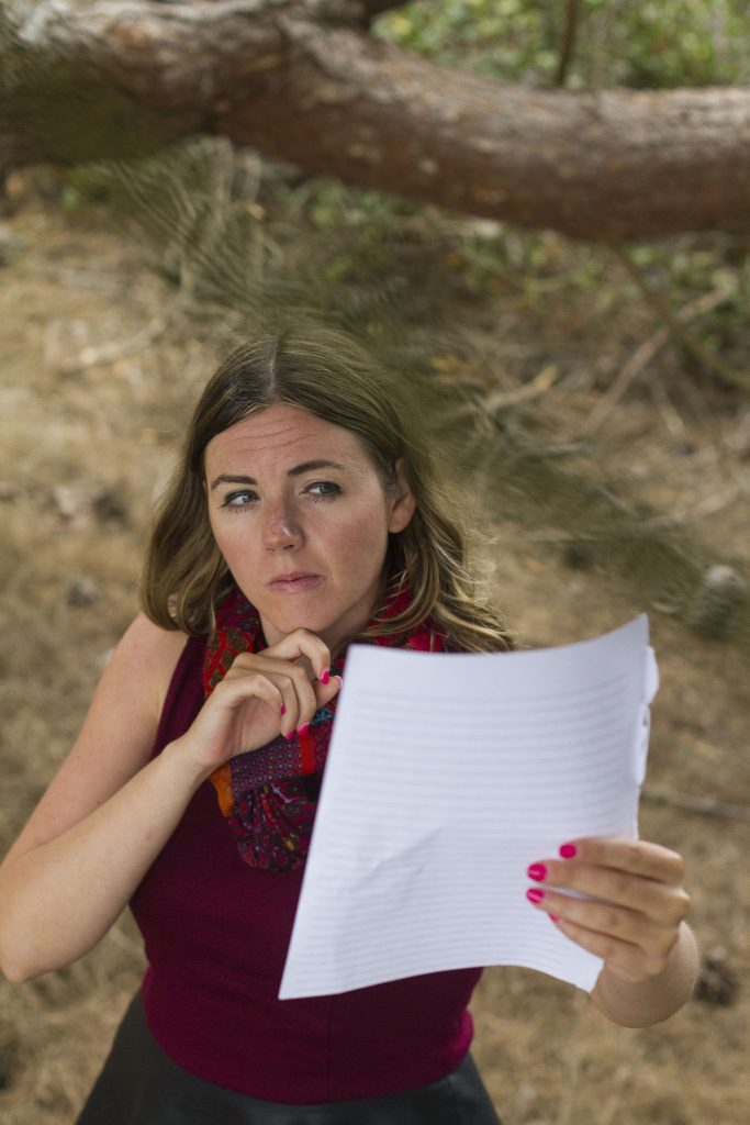 Allison Doody, senior theater student at San Francisco State University, pretends to practice her lines at Lake Merced August 25, 2015.  (Angelica Ekeke / Xpress)