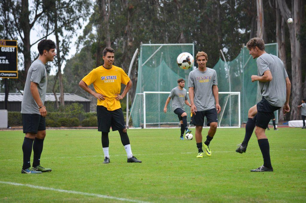 Members of the SF State men's soccer team pass the soccer ball around during practice at Cox Stadium Friday, August 21. (Melissa Minton / Xpress)