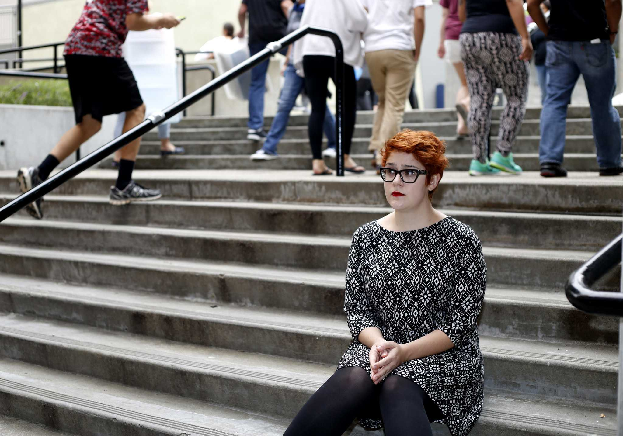 Darcy Fracolli, senior and managing editor of the Golden Gate Xpress poses for a portrait in front of the Towers at Centennial Square at SF State Thursday Aug. 20. (Emma Chiang / Xpress)