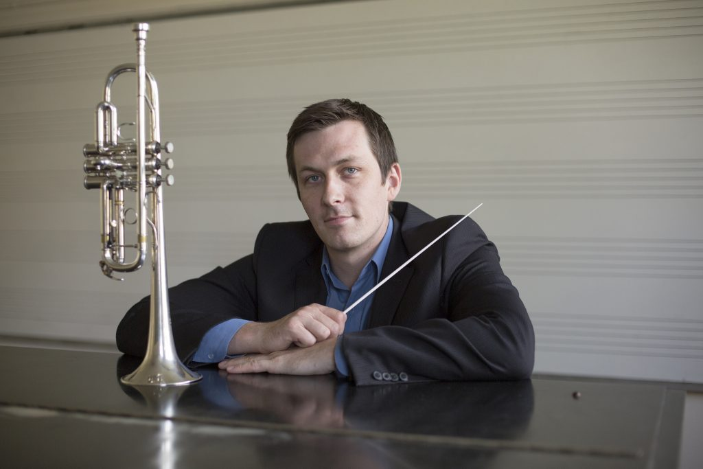 Brad Hogarth in his first semester at SF State as Assistant Professor of conducting and wind ensemble poses for a portrait in the creative arts building on Tuesday, August 25, 2015. (Ryan McNulty / Xpress)