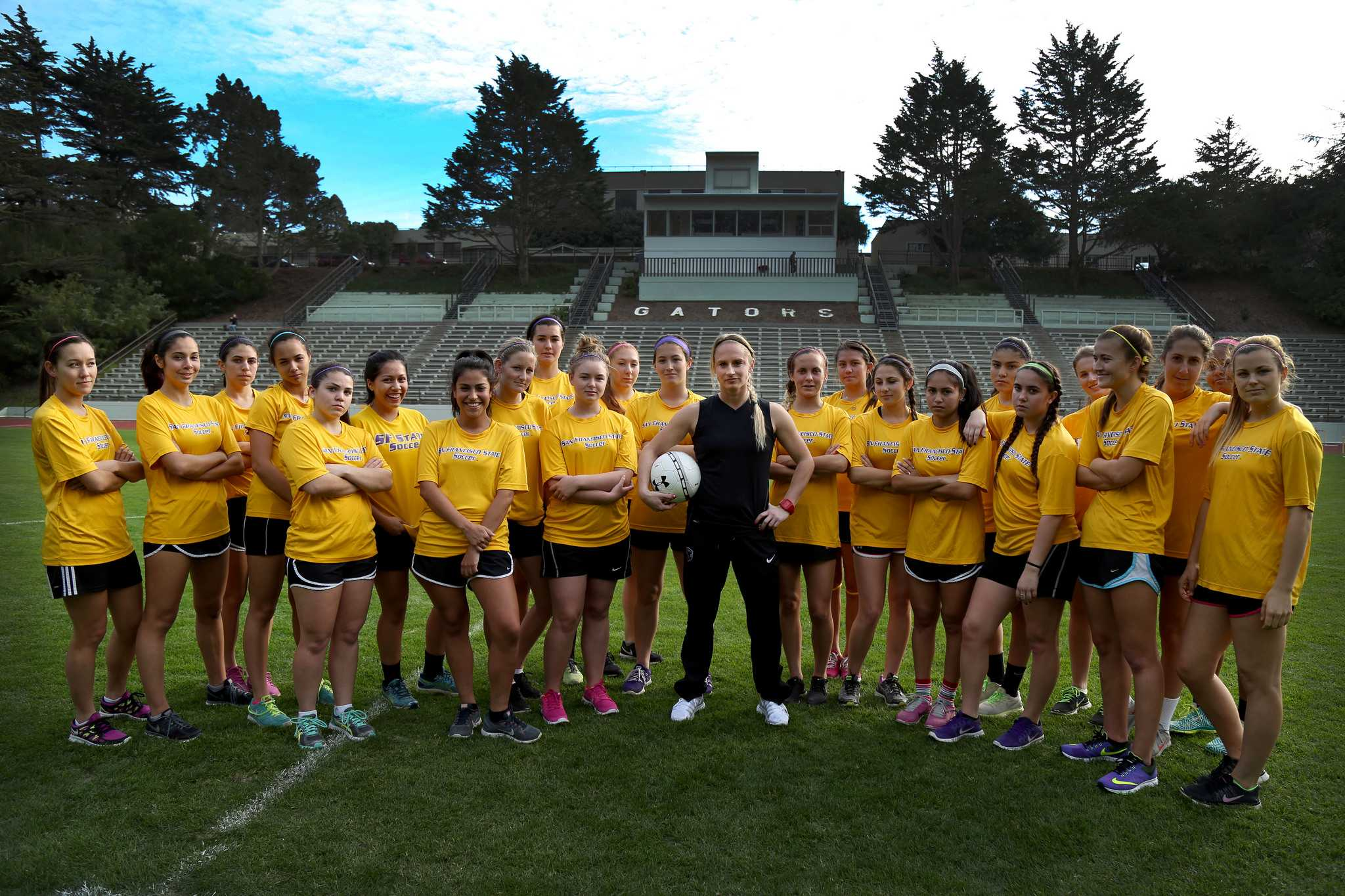 Tracy Hamm, SF State's new Head Women's Soccer Coach is the second in the 33-years, succeeding Jack Hyde. Hamm poses with the team at Cox Stadium Monday, Feb. 2, 2015. (Emma Chiang / Xpress)