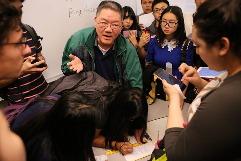 Finance Department Chair Ping Hsiao takes down the names of students with prerequisites who were waiting to be added to a new Finance 350 section in the Business building at San Francisco State University on Thursday August 27, 2015. (Joel Angel Juárez /  Xpress)