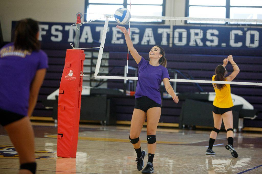Jessica Nicerio practices ball control during women's volleyball practice at SF State in the gym on Monday Aug. 31. (Ryan McNulty / Xpress)