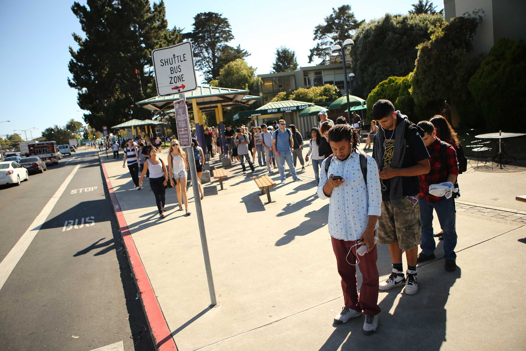 Students wait in line for the SF State shuttle to Daly City BART on 19th Avenue in front of campus Wednesday, Sept. 9, 2015. (Joel Angel Juárez /  Xpress)