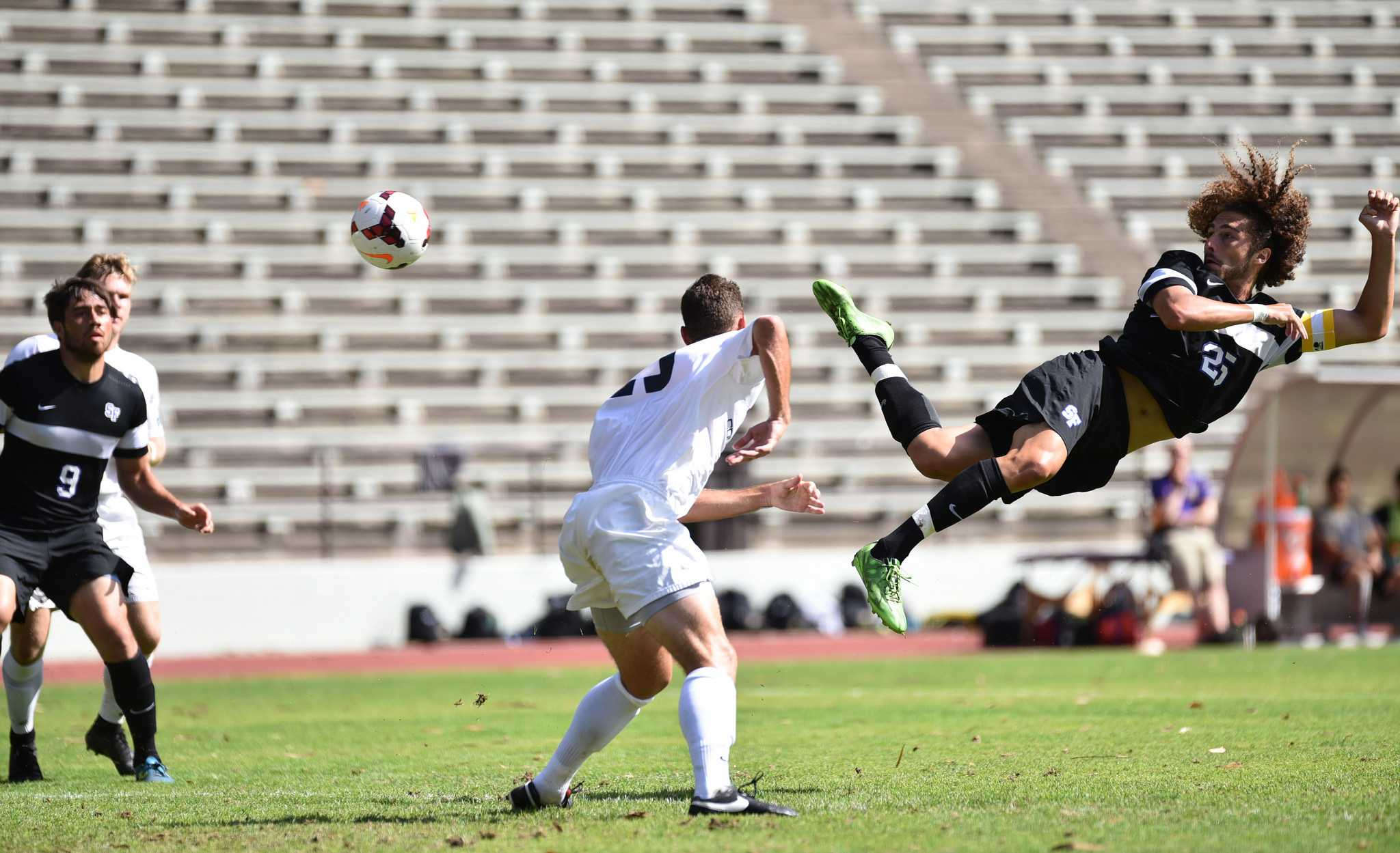Max Talbert (25) defender for SF State, heads the ball toward the goal during first half against Concordia University in 1-0 win at SF State's Cox Stadium Sunday, Sep.6. (Qing Huang/Xpress)