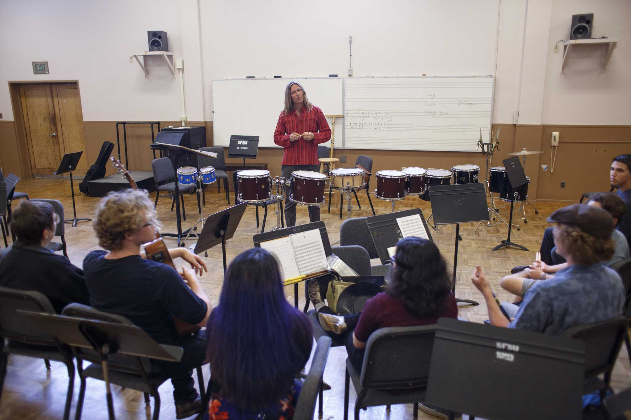 Donald Biggs talks with his percussion ensemble students at the beginning of class about the possibility of their class being cut on Thursday Sept. 3, 2015 in the creative arts building at SF State. ( Ryan McNulty / Xpress )