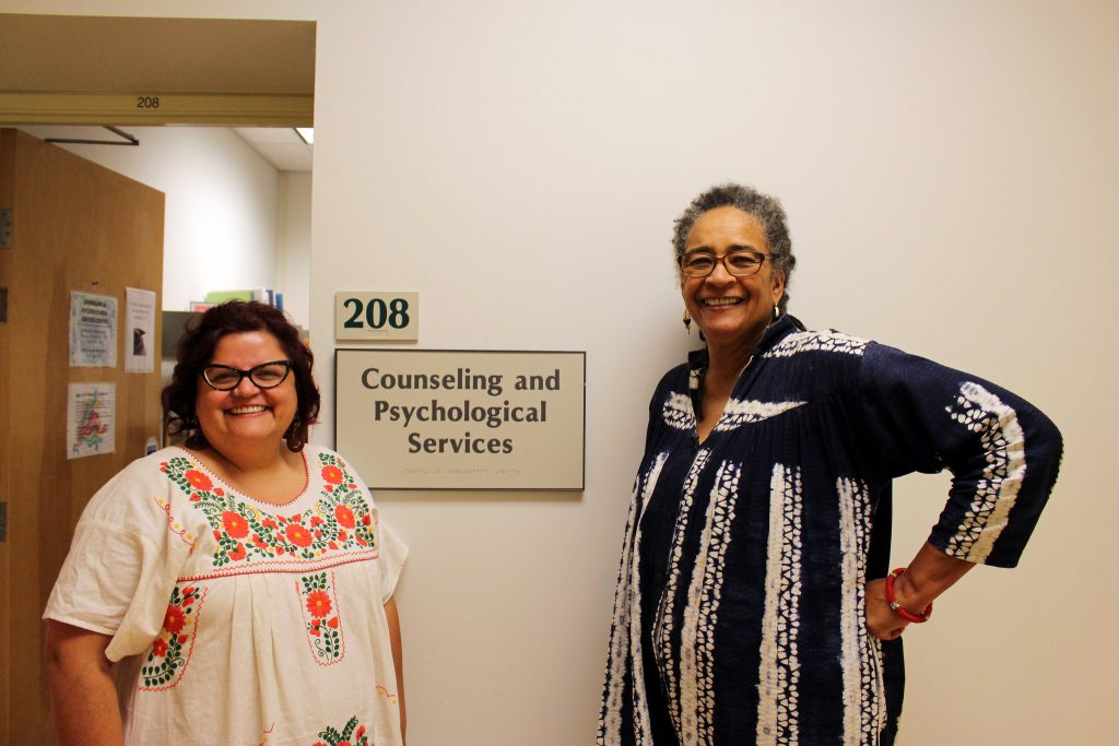 (right to left) Derethia DuVal, Ph. D, director of San Francisco State's Counseling and Psychological Services and Laurene Dominguez, SF State's SAFE place advocate, pose for a portrait in front of their office in the Student Services building. (James Chan/Xpress)