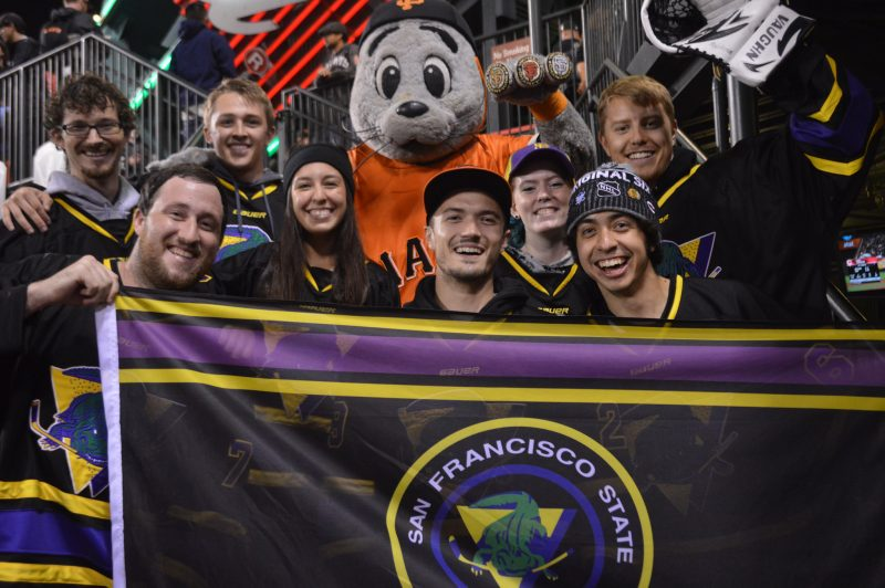 The SF State hockey team poses with mascot, Lou Seal, September 16, 2015 (Tyler Lehman / Xpress)