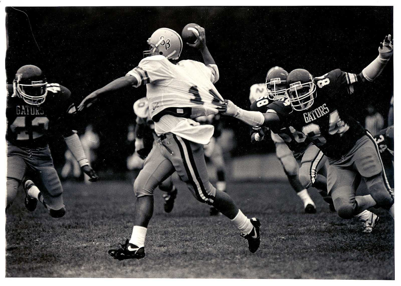 Defensive end Harry Overstreet II (84), SF State alumnus and former Gator football player tackles UC Santa Barbara Gauchos quarterback at Cox Stadium on Aug. 24, 1988. SF State lost with a final score of 6-16. (Photo Courtesy of Harry Overstreet II)