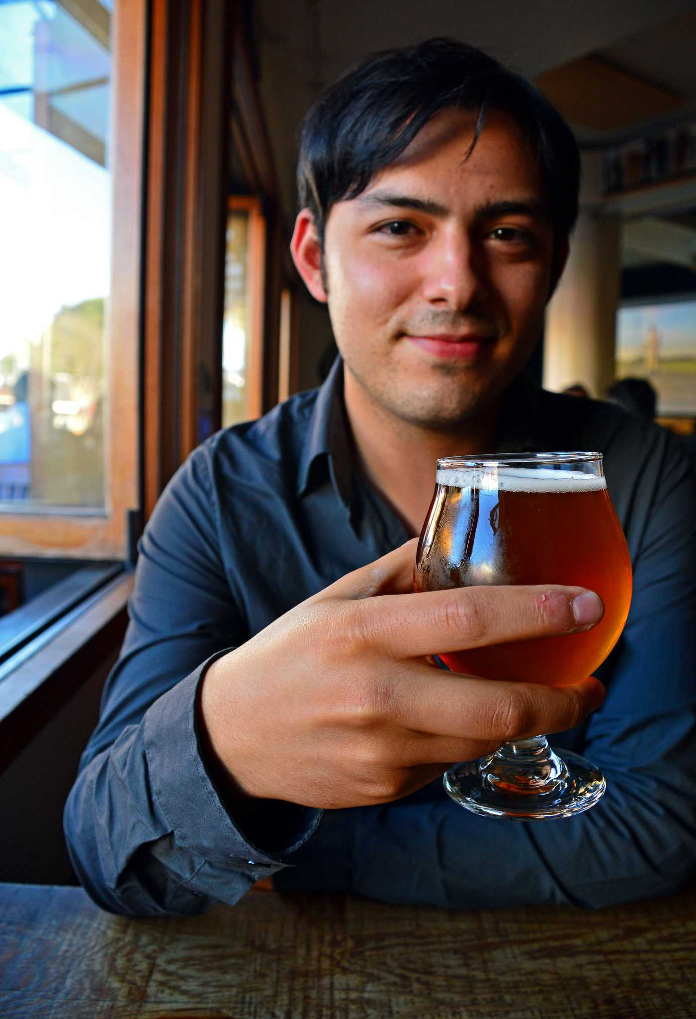 SF State alumni, Sam Molmud, editor-in-chief of Liquid Bread, at the Rosamunde Sausage Grill in San Francisco, Thursday evening, September 10, 2015 (Katie Lewellyn / Xpress).