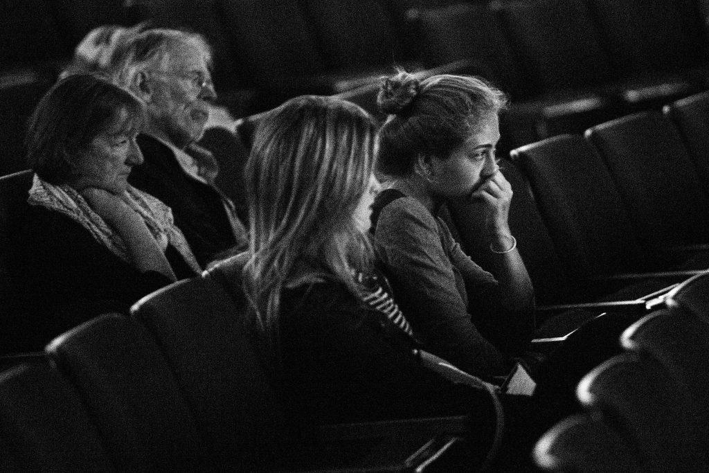 Vanessa Ibarra, English major, watches the screening of Private Violence a documentary on domestic violence in the McKenna Theatre at SF State Thursday, Sept. 17. 2015. (Ryan McNulty / Xpress)