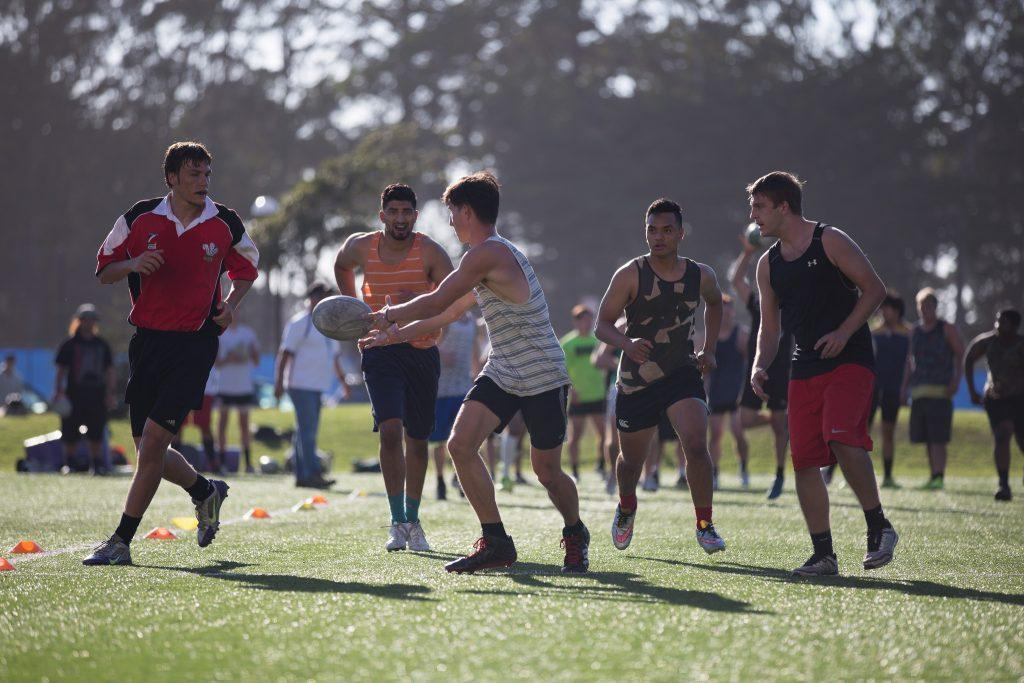 Members of the SF State Rugby Team run passing drills during practice on the West Campus Green, Friday, Sept. 18, 2015. (Brian Churchwell / Xpress)
