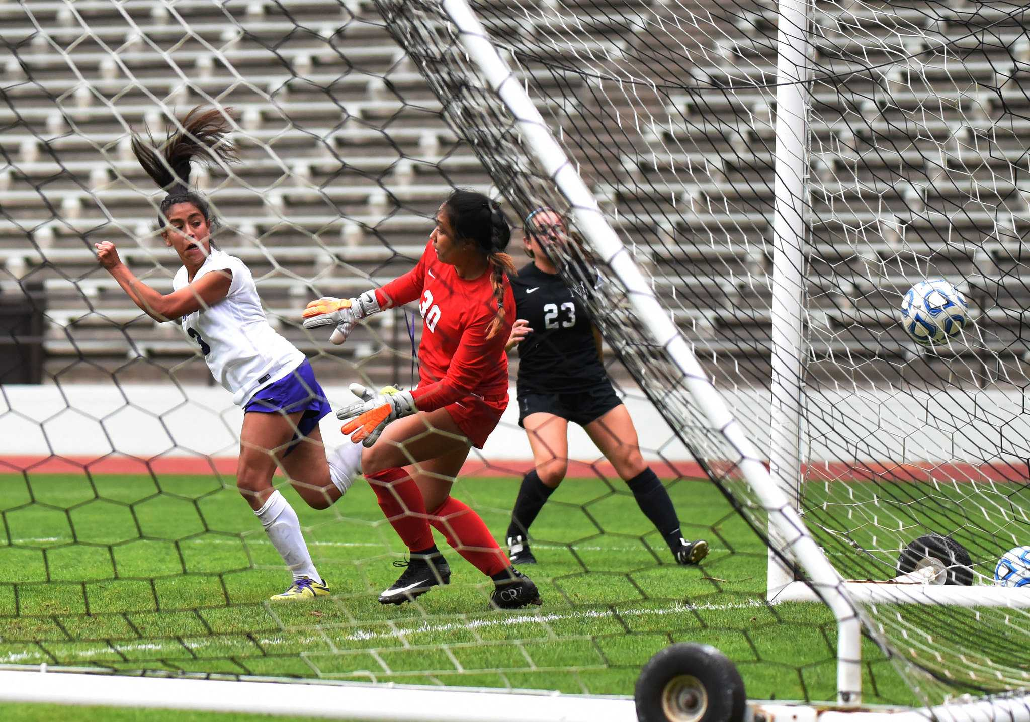 Danielle Vidal (3), midfielder for SF State Gators, heads the ball to score the first goal during the first half against Holy Names University Hawks at Cox Stadium at SF State Tuesday, Sep. 22. SF State Gators won 5-1. (Xpress / Qing Huang)