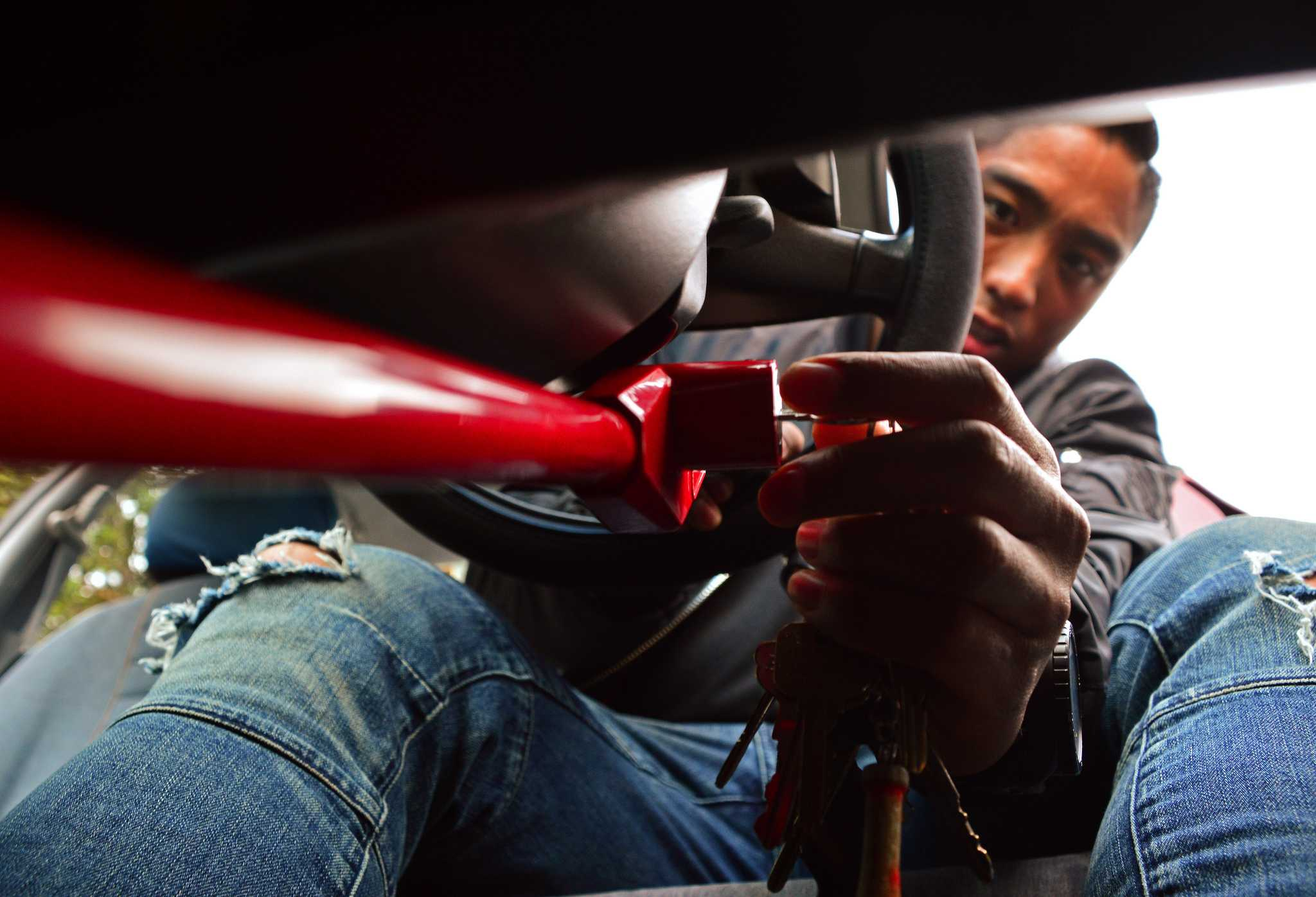 SF State biology teaching associate, Michael Cala, is applying his pedal break in his sister's vehicle to get around while his car is being repaired in a shop on Monday afternoon, Lake Merced Blvd., Daly City, September 28, 2015 (Katie Lewellyn / Xpress)