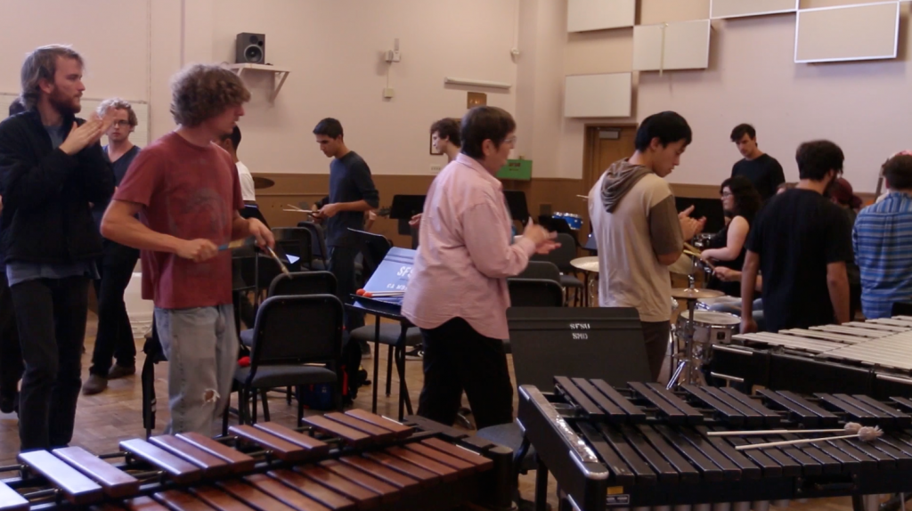 Students+warm+up+to+a+drum+circle+before+the+start+of+their+percussion+ensemble+class.+%28Xpress+Staff%29
