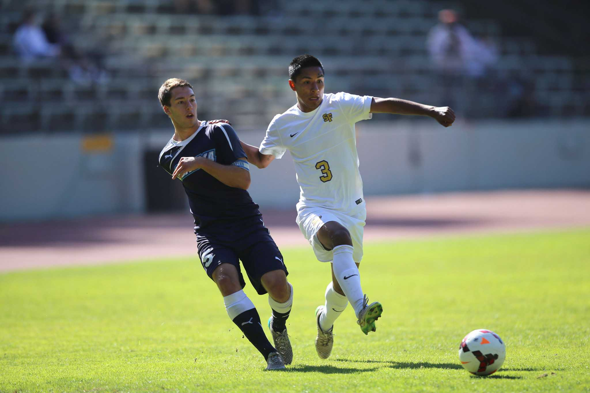 Sonoma State Seawolves defender Dane Shaffar (5) battles with SF State Gators midfielder Armando Flores (3) during a 0-0 draw at Cox Stadium in San Francisco, Calif., Friday, Oct. 2, 2015. (Brian Churchwell / Xpress)