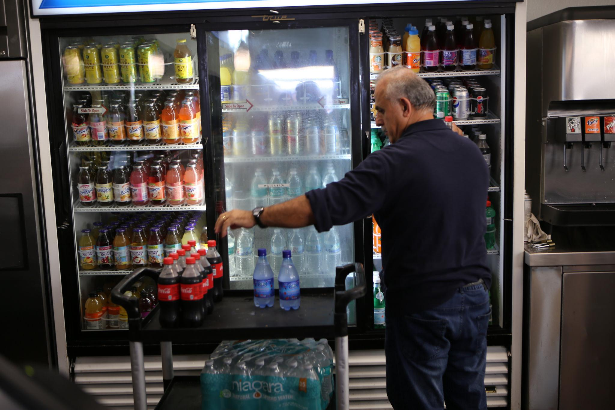 Nazih Ibrahim, a Gold Coast Grill & Catering employee, restocks beverages in the Gold Coast Grill & Catering vendor store at SF State Friday Oct. 2. The University Corporation (UCorp) is looking to establish an exclusive partnership with SF State regarding pouring rights to beverages on campus according to UCorp's recent proposal. (Joel Angel Juárez / Xpress)