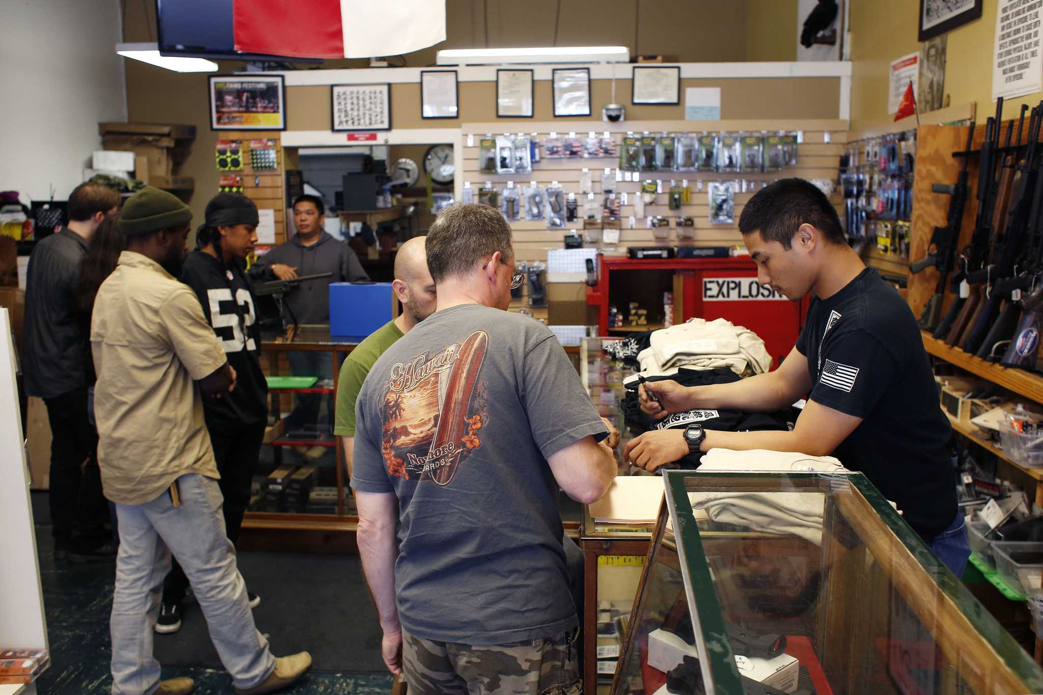 Customers visit Higher Bridge Arms Inc., the last gun shop in San Francisco Sunday, Oct. 4, 2015. The store located in the Mission District will be permanently closing Oct. 31 due to the city's political climate of increased gun control regulations. (Emma Chiang / Xpress)
