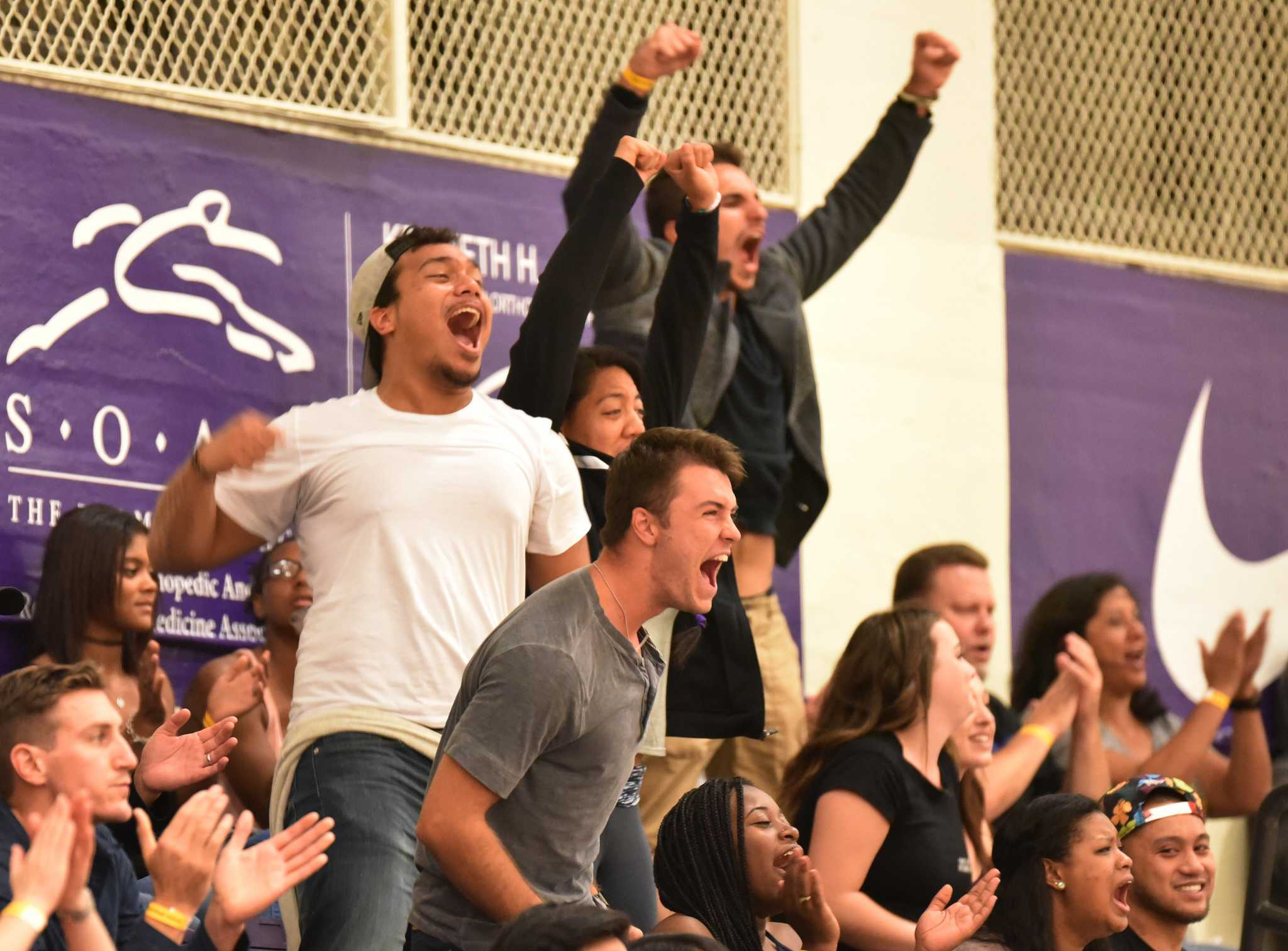 David Tui, left, and other fans cheer for SF State Gators during the game won 3-1 against Cal State East Bay Pioneers at the Swamp at SF State Saturday, Sep. 19. (Qing Huang / Xpress