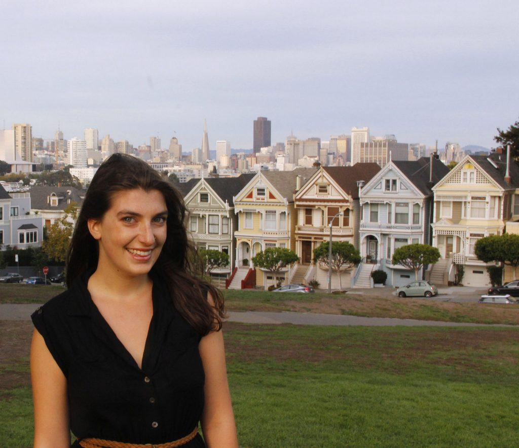 Jessica Nemire, journalism senior poses for a portrait in front of Painted Ladies Thursday, Oct. 8 (Imani Miller / Xpress)