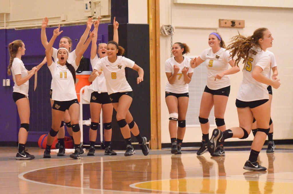 SF State women's volleyball team cheers after SF State scores a point during the game against Humboldt State University at the Swamp Friday, Oct. 16. SF State won 3-0. (Melissa Minton / Xpress)