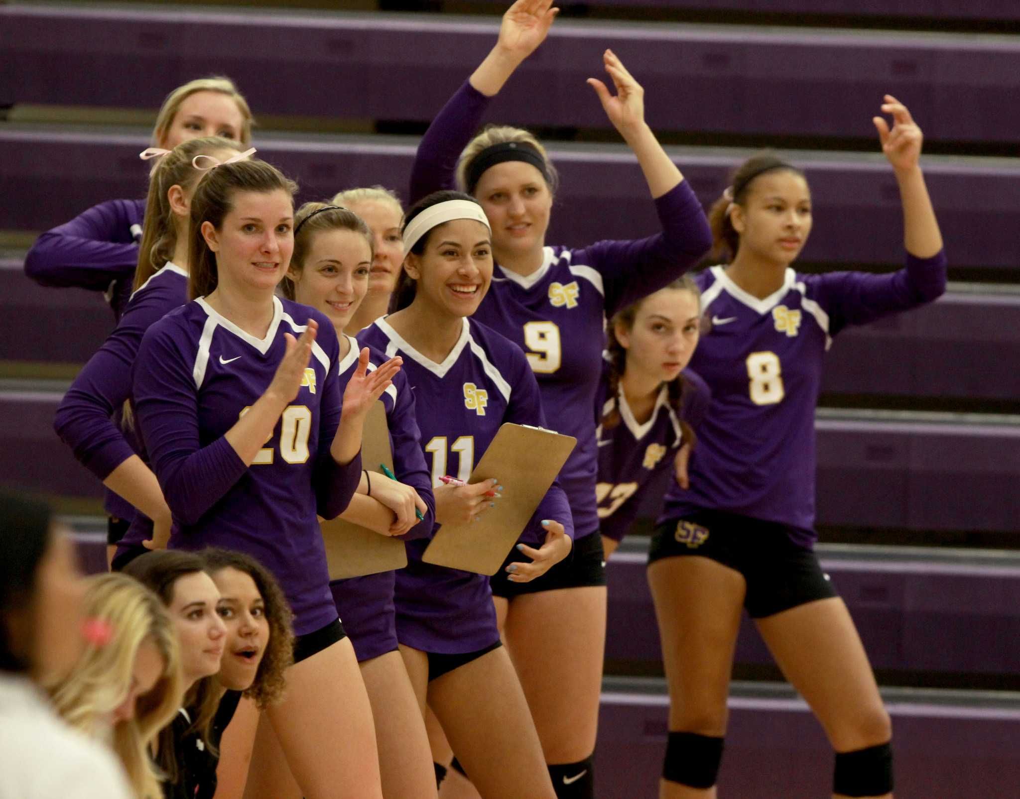 SF State Women's Volleyball team cheers on their teammates from the side lines after winning against California State Dominguez Hills Saturday, Oct. 3, 24- 15. (Angelica Williams / Xpress)