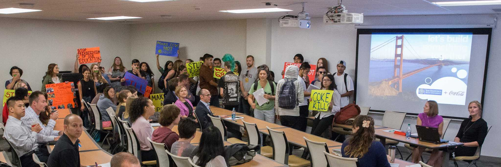 Students oppose the sale of pouring rights at SF State by disrupting a town hall meeting  with Coca-Cola, a potential company that may begin supplying all beverages on campus Wednesday, Oct. 14, 2015. (Brian Churchwell / Xpress)