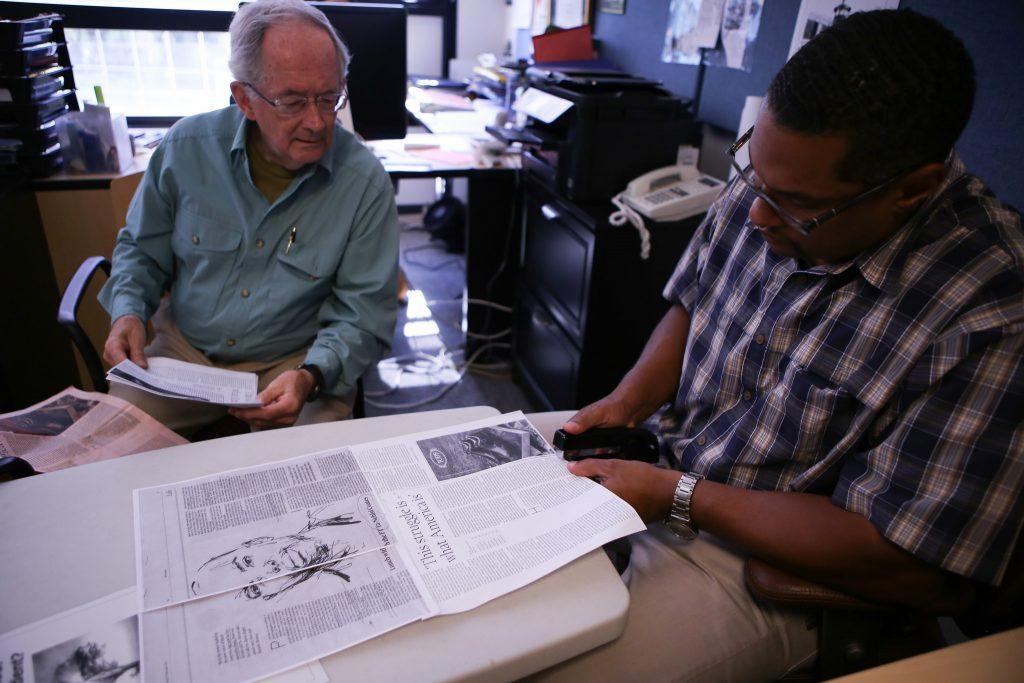 Bob Tunnell (left), a Project Rebound volunteer advisor, and C. Jason Bell (right), the Project Rebound Director, put together an article for students to read at the Project Rebound office located in the Cesar Chavez Student Center Tuesday, Oct. 6. (Joel Angel Juárez / Xpress)