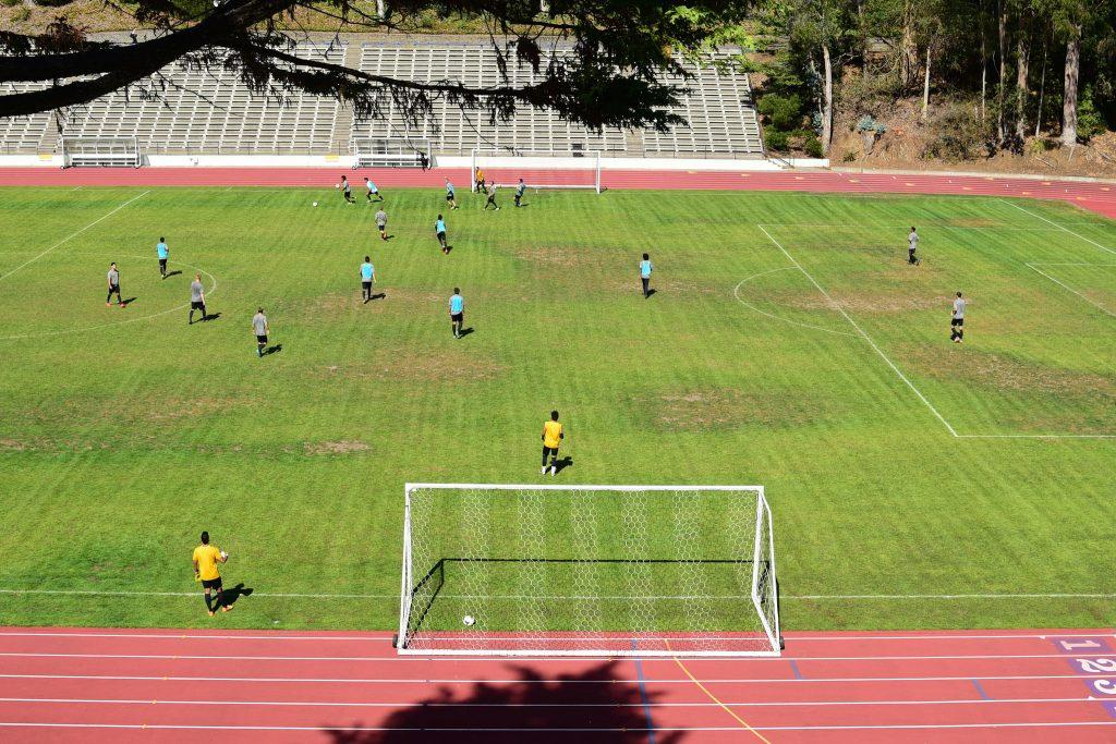 The SF State Gators men's soccer team practices on dirt patches at Cox Stadium Tuesday, Oct. 6. SF State Grounds Operations plans to restore the field by the end of October.  (David Henry / Xpress)