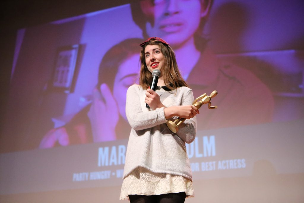 Marian McColm, a senior cinema major, receives the Silver Tripod for Best Actress award for her role in
