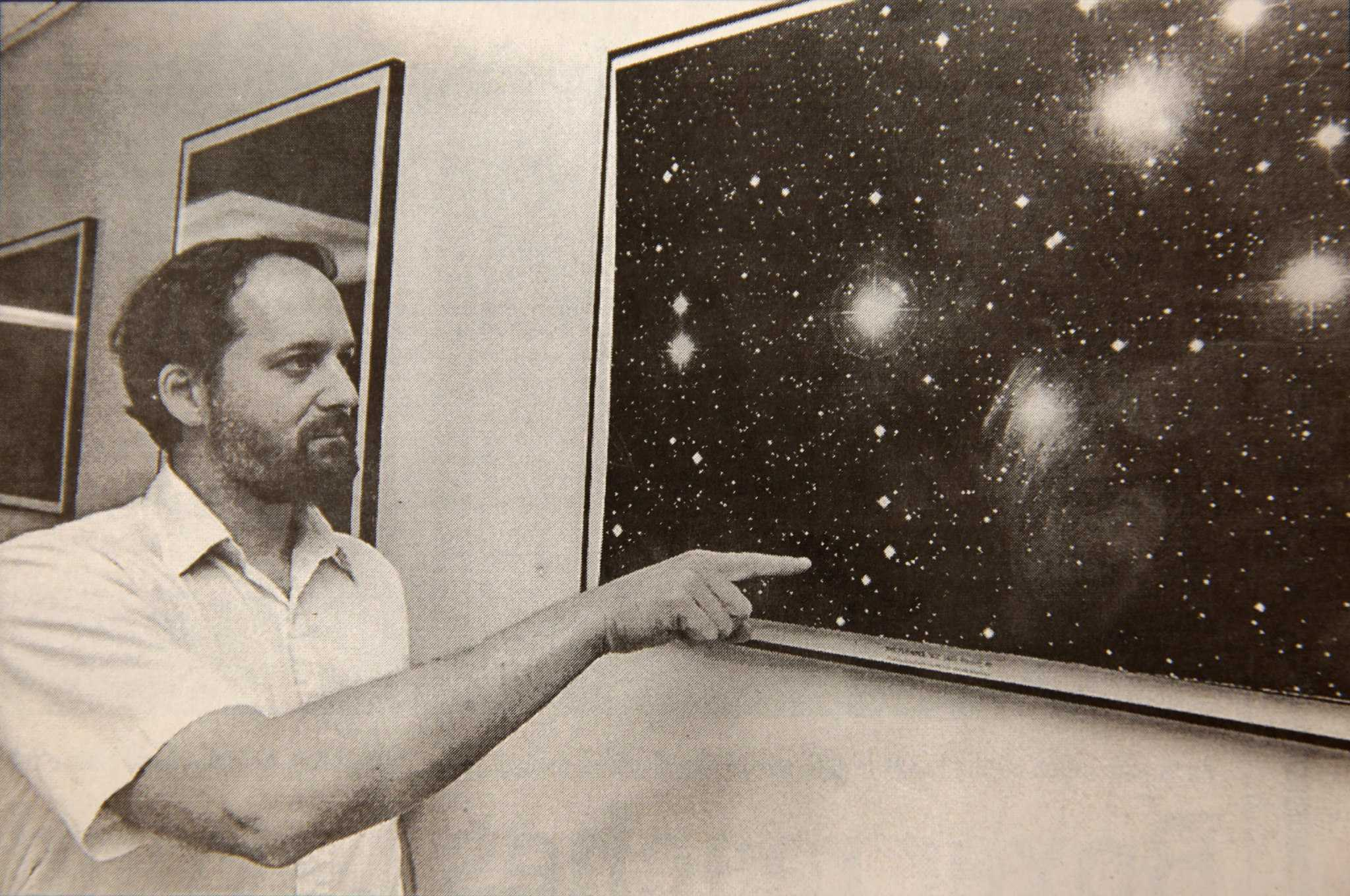 Geoff Marcy, professor of physics and astronomy, is part of a team which discovered a brown dwarf star near Pleides Cluster. Marcy is pointing to the area of detail where the dwarf is located. Photo by Edmund Lee for the Golden Gator published on August 31, 1995.
