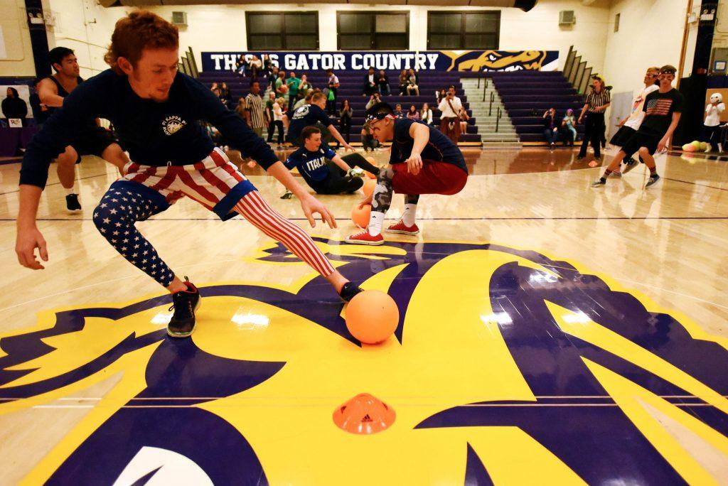 Teams battle for the ball in the championship dodgeball match at the SF State ASI's costume dodgeball tournament at The Swamp, Friday, Oct. 23. (David Henry / Xpress)