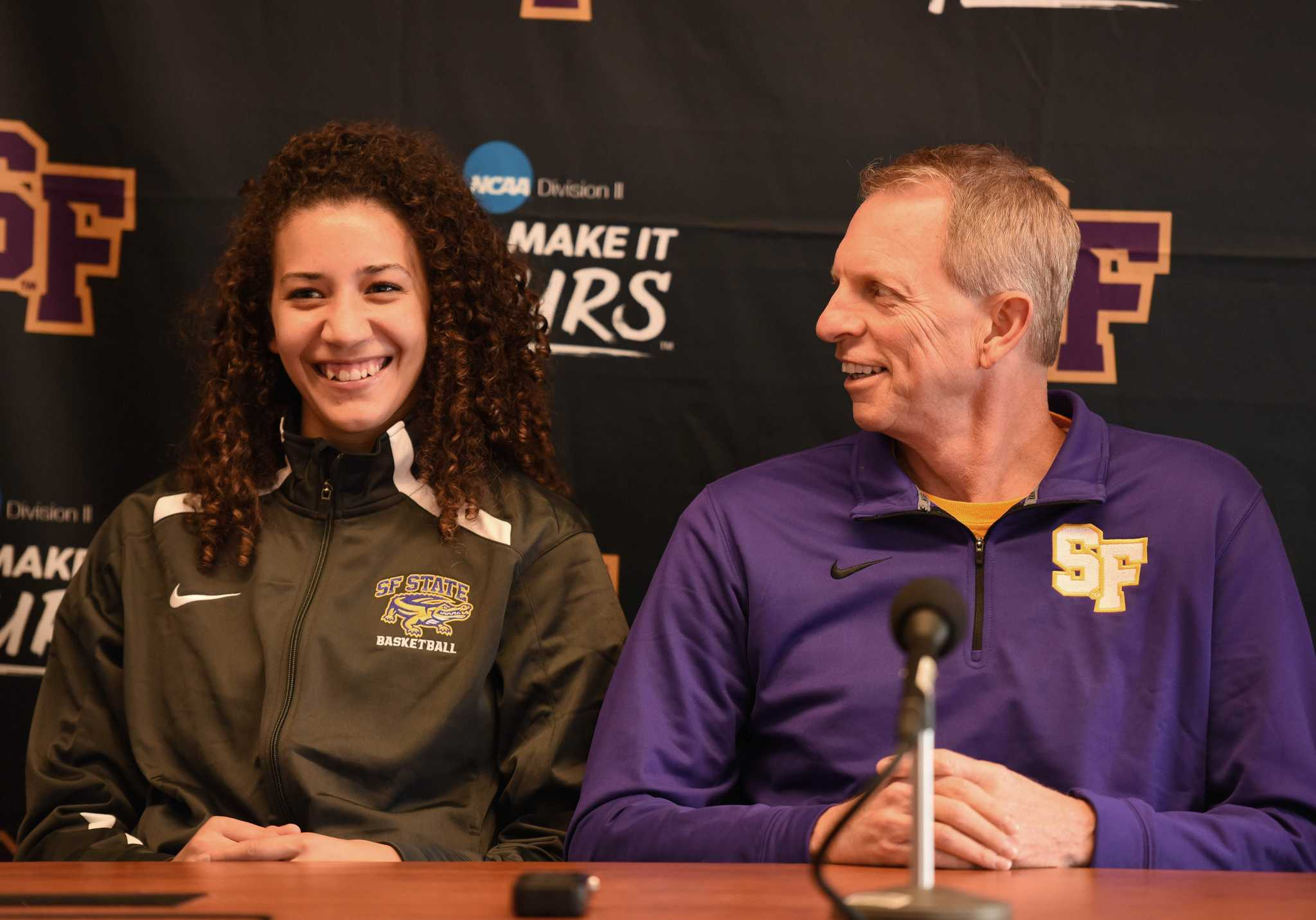 SF State Gators women's basketball player Laura Lawson (left) and head coach Dennis Cox smile as they field questions in the press room of the Gymnasium building Wednesday, Oct. 28. (David Henry / Xpress)