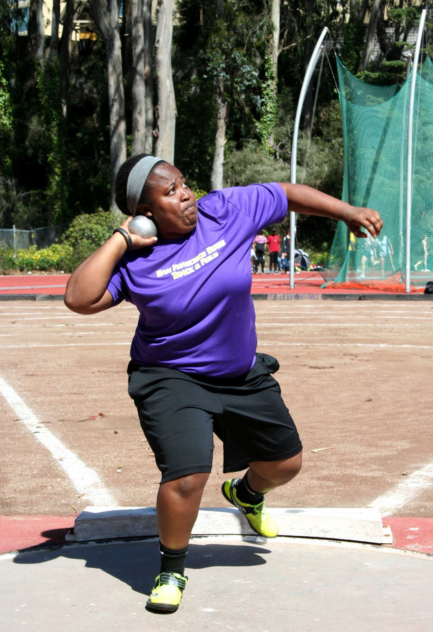 Ariana Luster, an SF State student and track and field athlete, died Wednesday, Oct. 21 after battling cancer. She was a member of the Gator's track and field team in 2013-2014. Luster prepares to throw a weight during a regular tack and field practice at the SF State track on Cox Stadium February 10, 2014.  (Photo Courtesy of SF State Athletic Department)