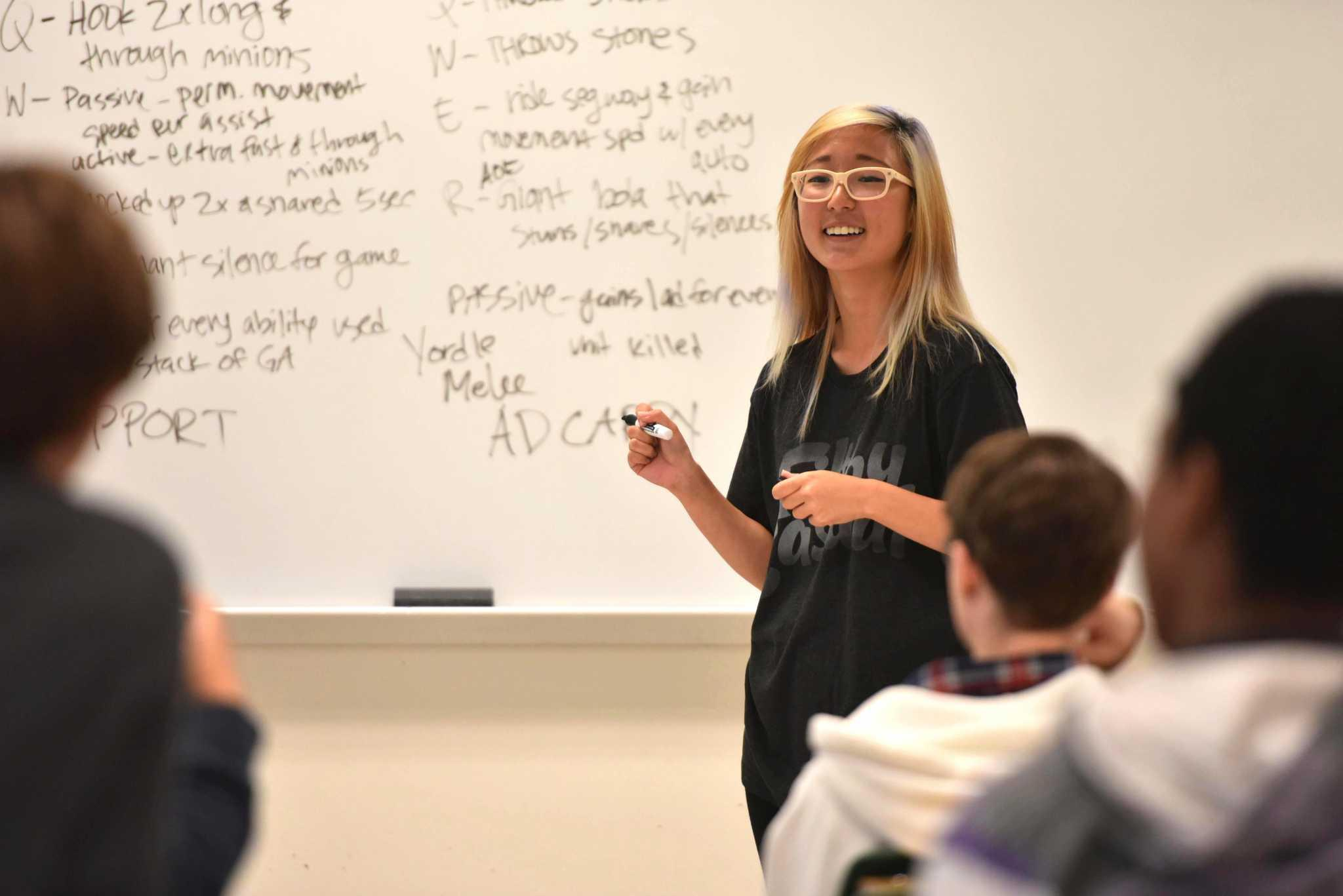 Esport Club president Jasmine Hong talks to the students joining the club at a classroom of Burk Hall at SF State Friday, Oct.16. (Qing Huang / Xpress)