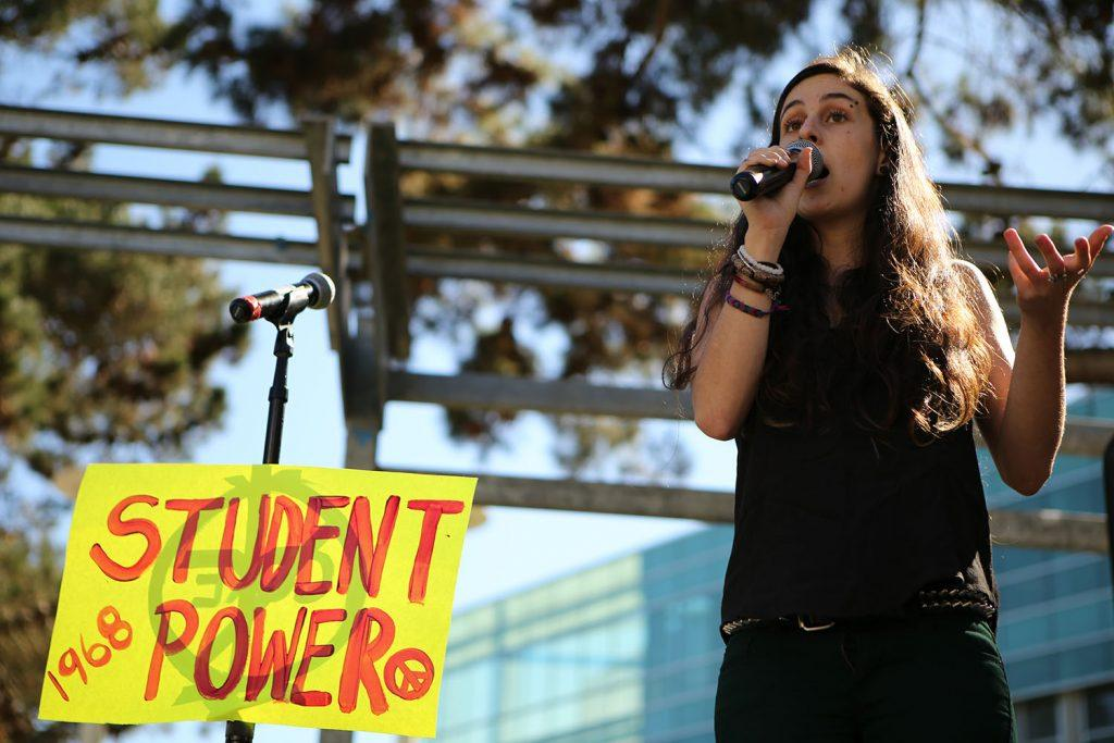 SF State Real Food Challenge member Celia LoBuono Gonzalez, a third year communications and geography major, speaks about pouring rights during the Speak Out rally in Malcom X Plaza on Tuesday, Oct. 20, 2015. ( Joel Angel Juárez / Xpress)