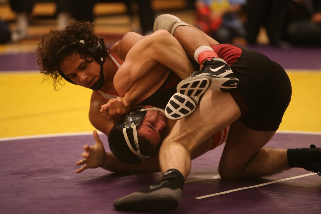 SF State Gators' Trevor Perez (left) grapples Stanford Cardinals' Peter Russo (right) during a match at the 48th Annual SF State Community College and College Open held at The Swap Sunday, Nov. 1, 2015. (Joel Angel Juárez / Xpress)