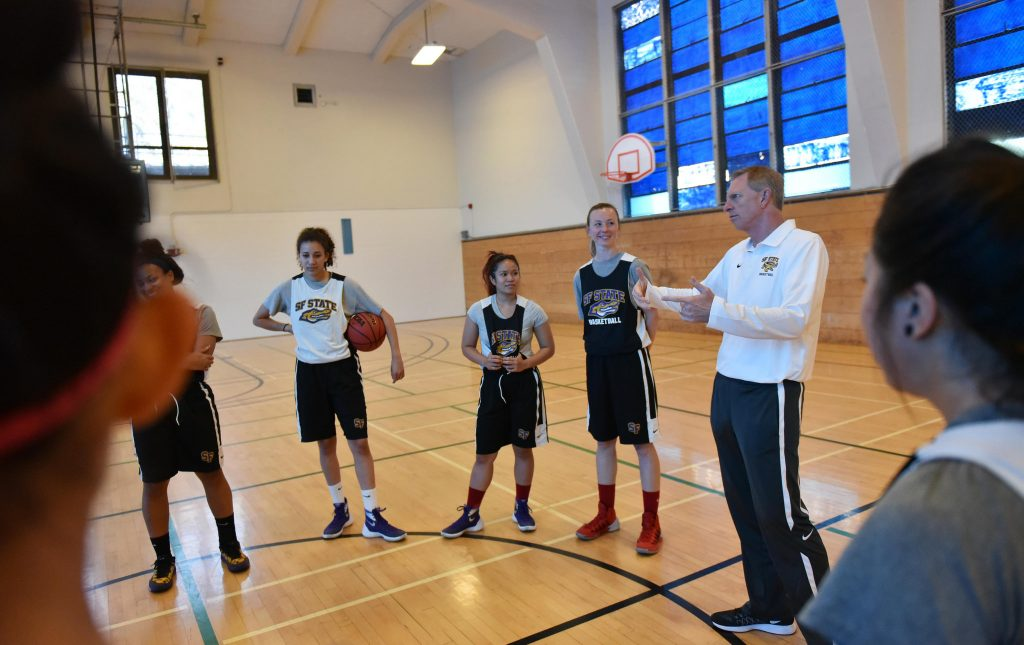 Dennis Cox, head coach of SF State women's basketball team, talks to SF State Gators during a practice at The Swamp at SF State Monday, Nov. 2. (Qing Huang/Xpress)