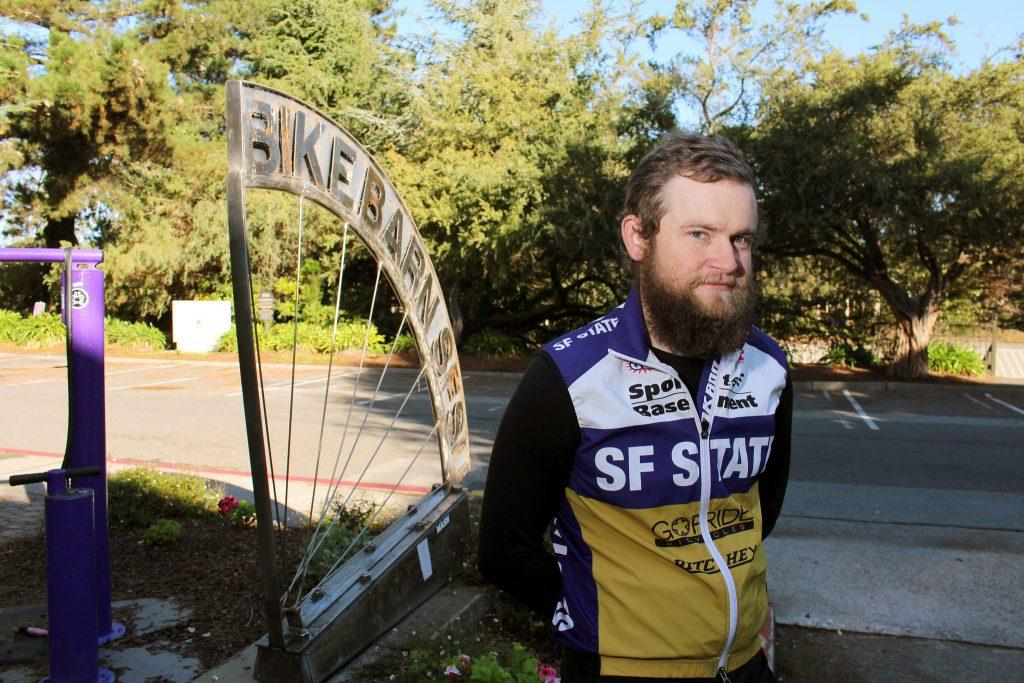 Nolen Brown, a member of the SF State Cycling team had his race bike stolen the weekend of Oct. 27 and 28. Brown poses for a portrait in front of the bike barn Tuesday, Nov. 3, 2015. (James Chan / Xpress)