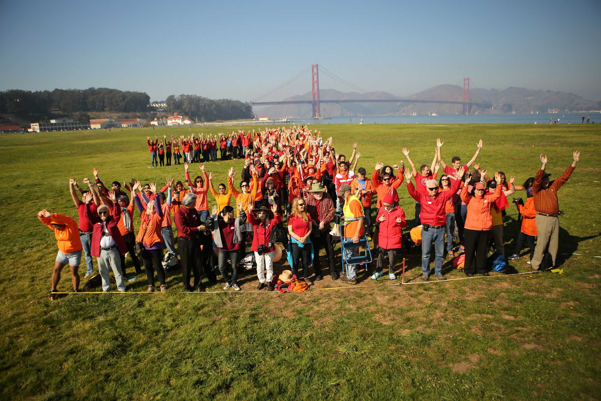 Participants form the figure 1 to celebrate the 100th anniversary of the National Park Service at Crissy Field in San Francisco November 14, 2015. (Joel Angel Juárez / Xpress)